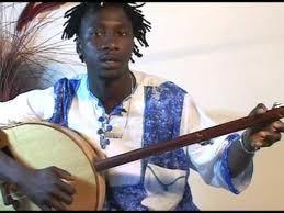 Sana Ndiaye performing an akonting style of banjo