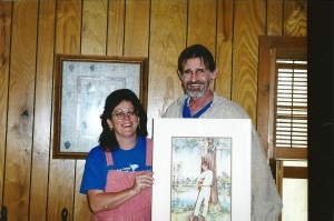 Holding a portrait given to him by Donna Green-Townsend and George Floyd painted by Mary Ann DiNella