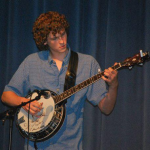 Lee doing a solo during a performance with the Tumblin Creek Bluegrass Band at P.K. Yonge High School in Gainesville